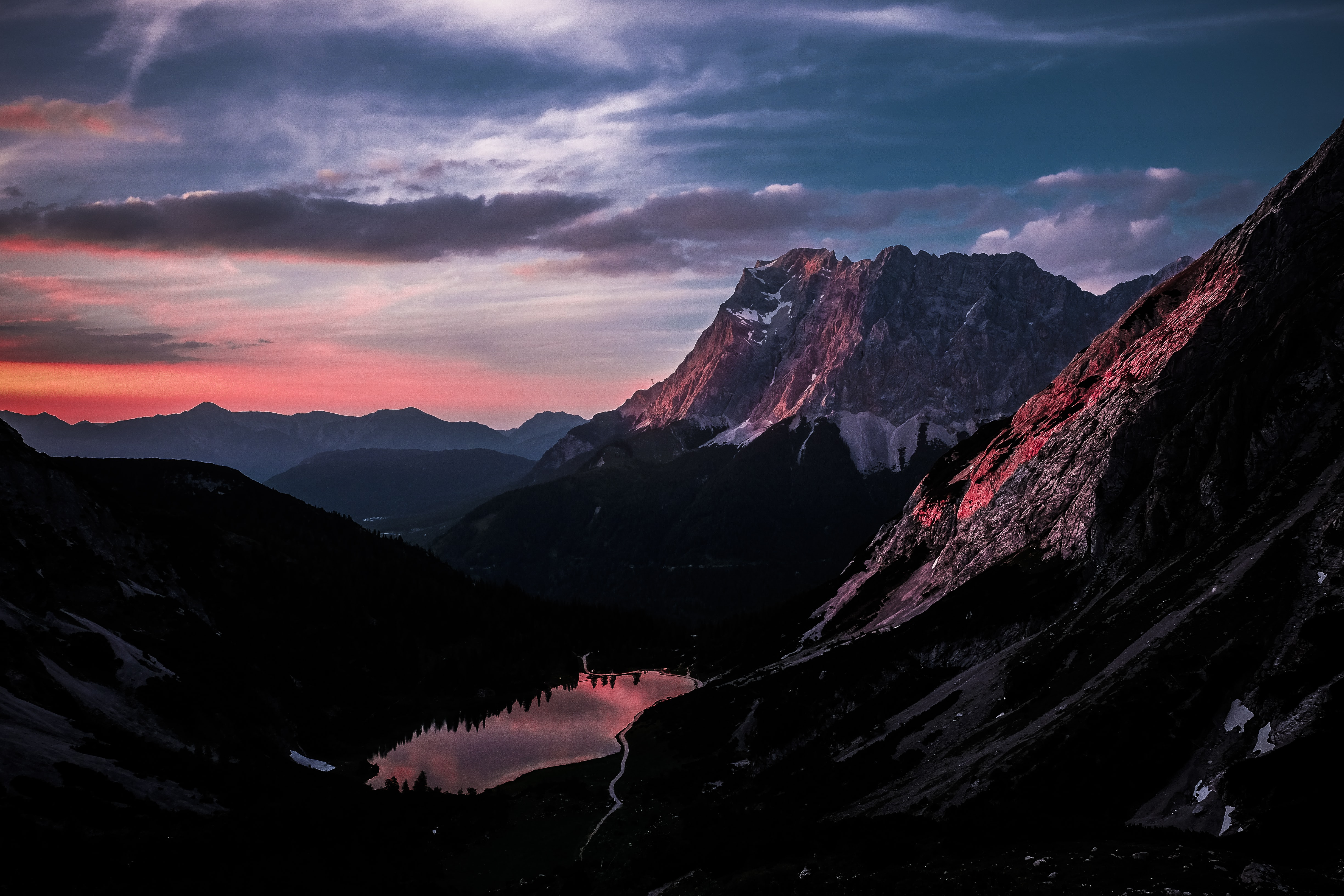 mountains with fog under blue and orange sky
