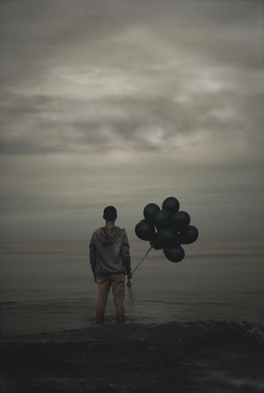 man holding balloons