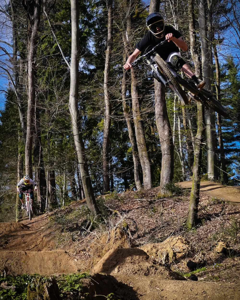 man riding on black downhill bike