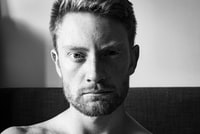 greyscale photo of topless man