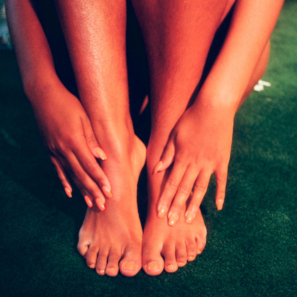 person's feet and hands