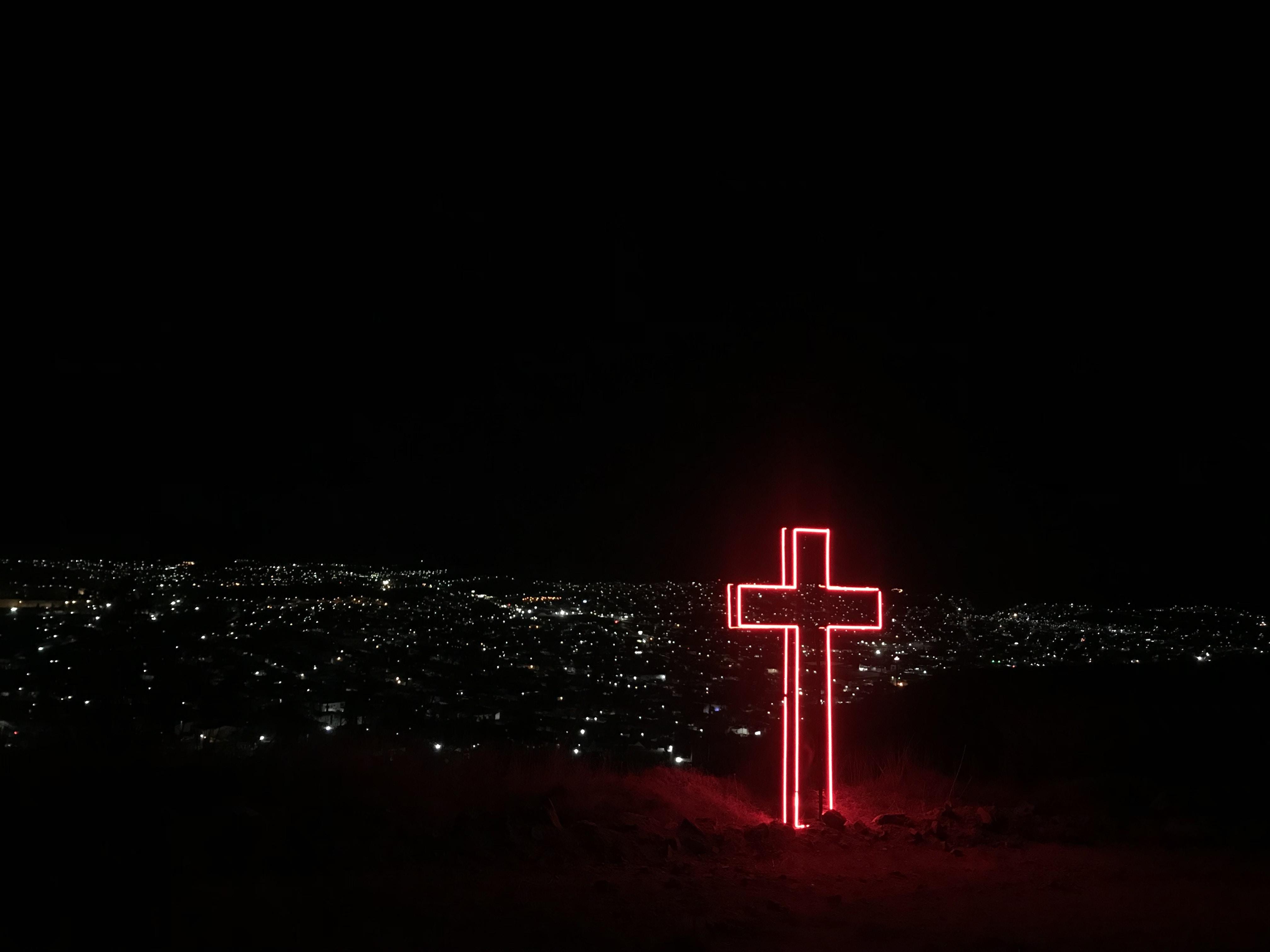 red neon light cross signage