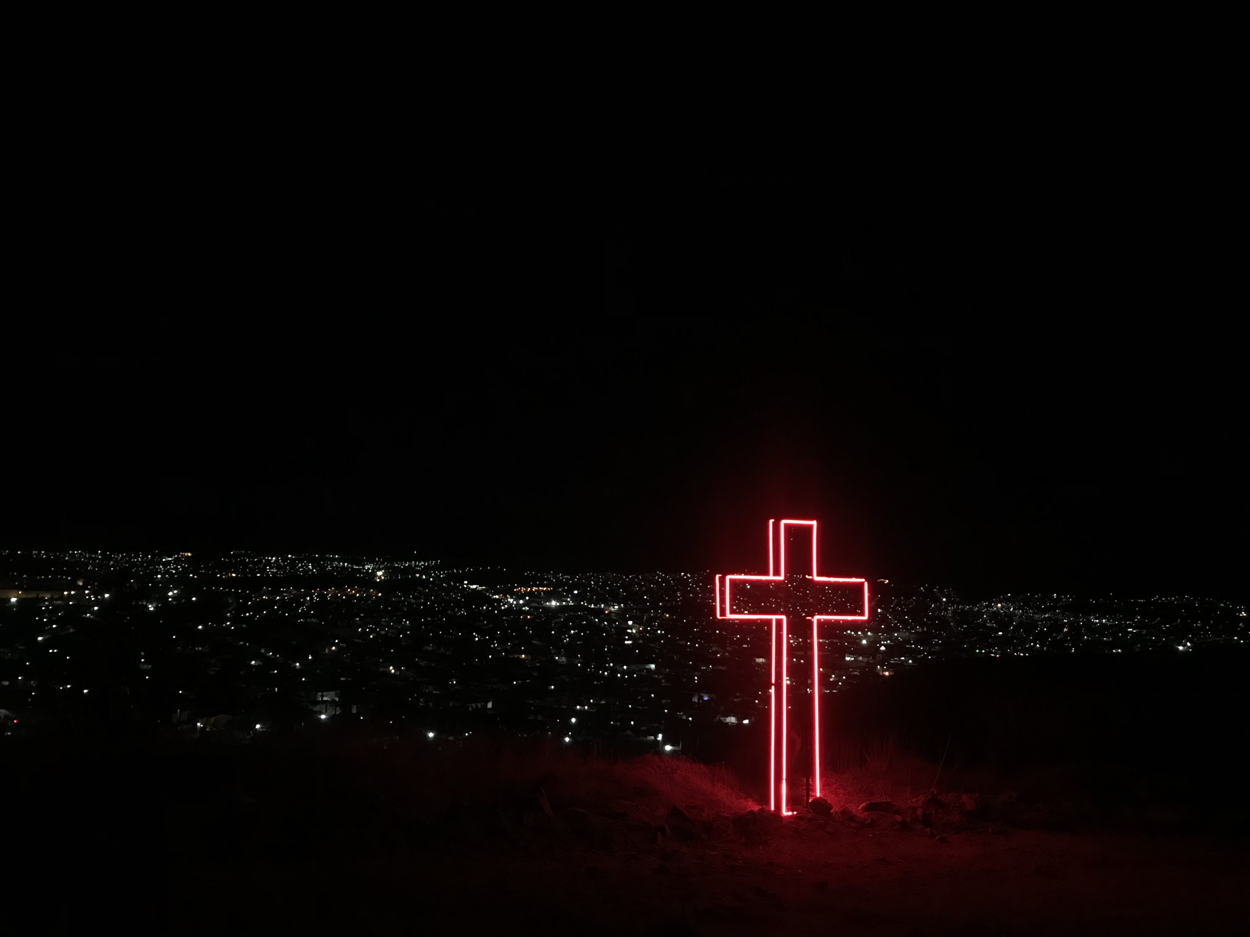 red neon light cross signage