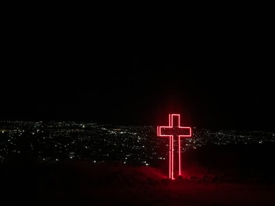 red neon light cross signage jesus zoom background