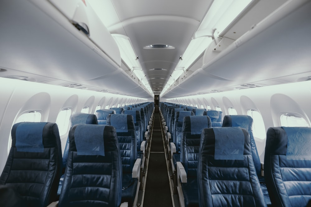 blue airplane interior with seats