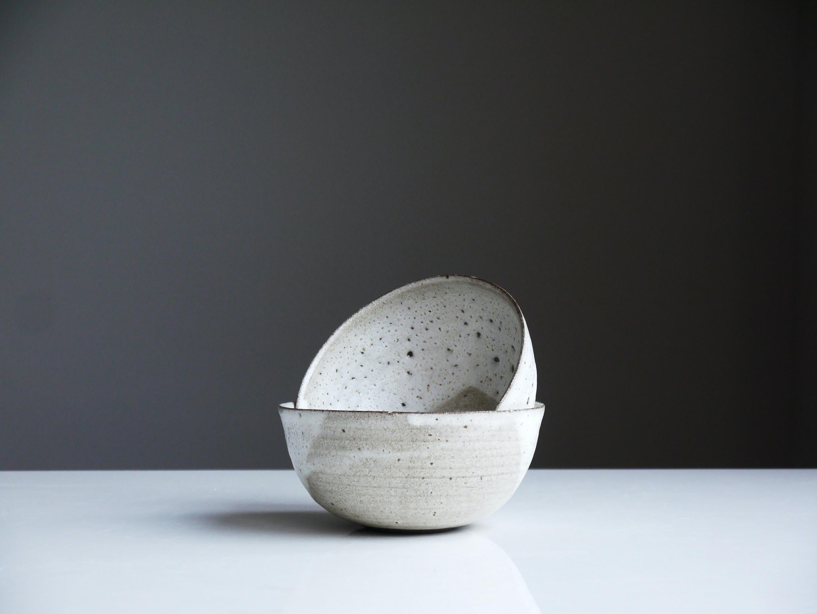 two white ceramic bowls