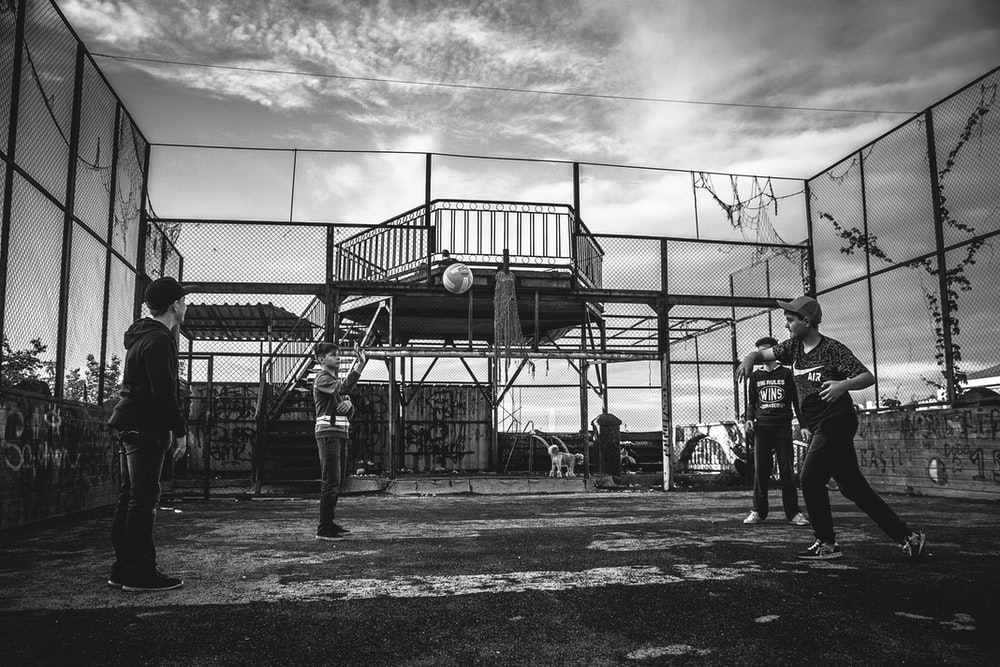 grayscale photo of group of boys playing baseball