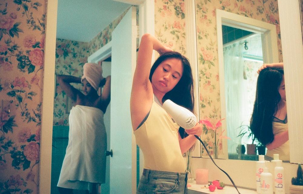 woman wearing white tank top