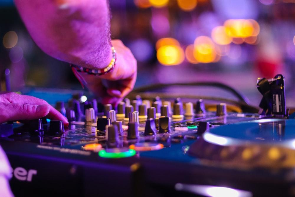 DJ controlling turntable at night