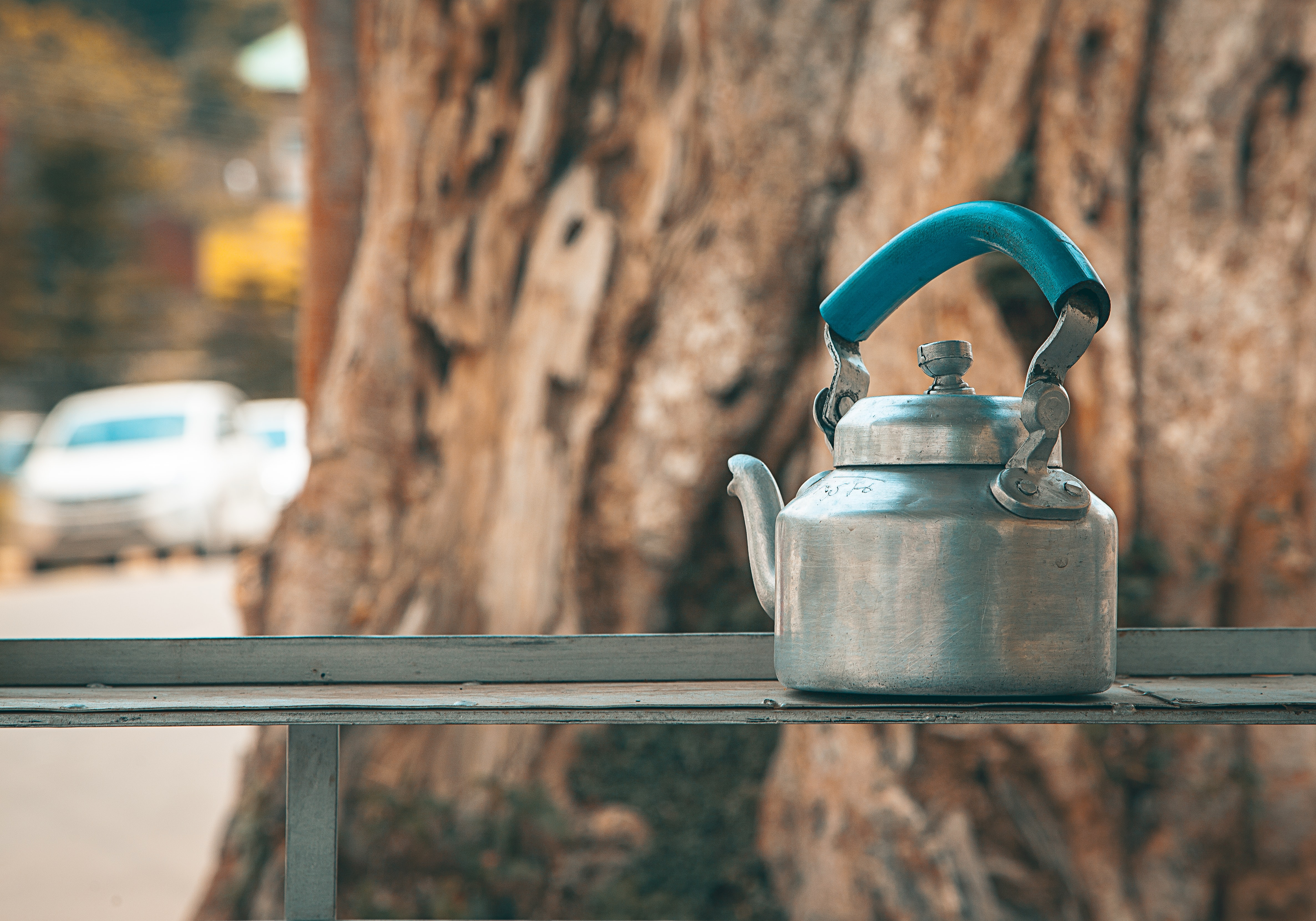 gray kettle on gray metal stand