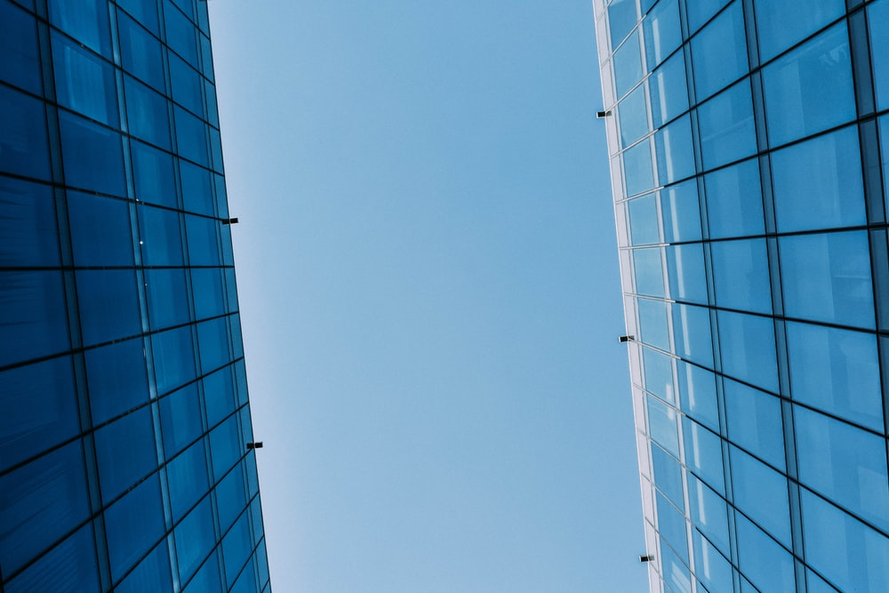 low angle photography of curtain wall building at day time