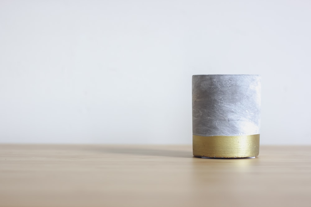 gray and gold metal decor on wood
