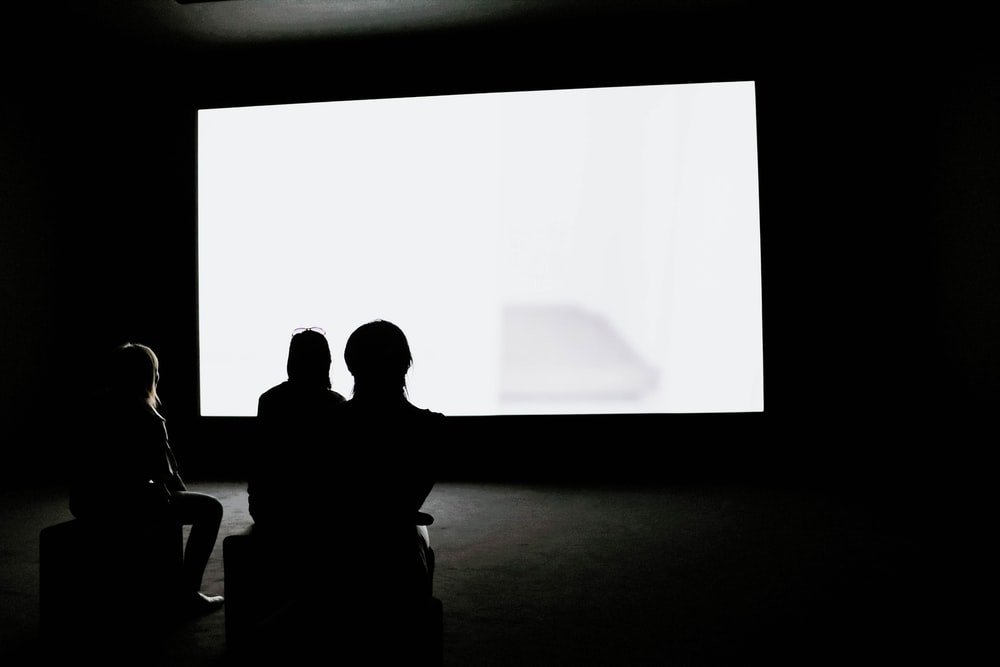 people looking on projection screen