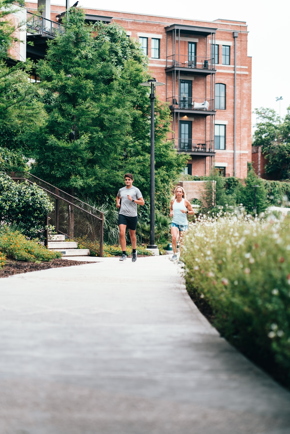 man and woman on path jogging