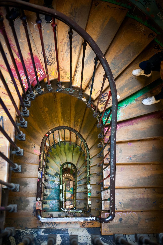 black metal framed brown wooden spiral ladder