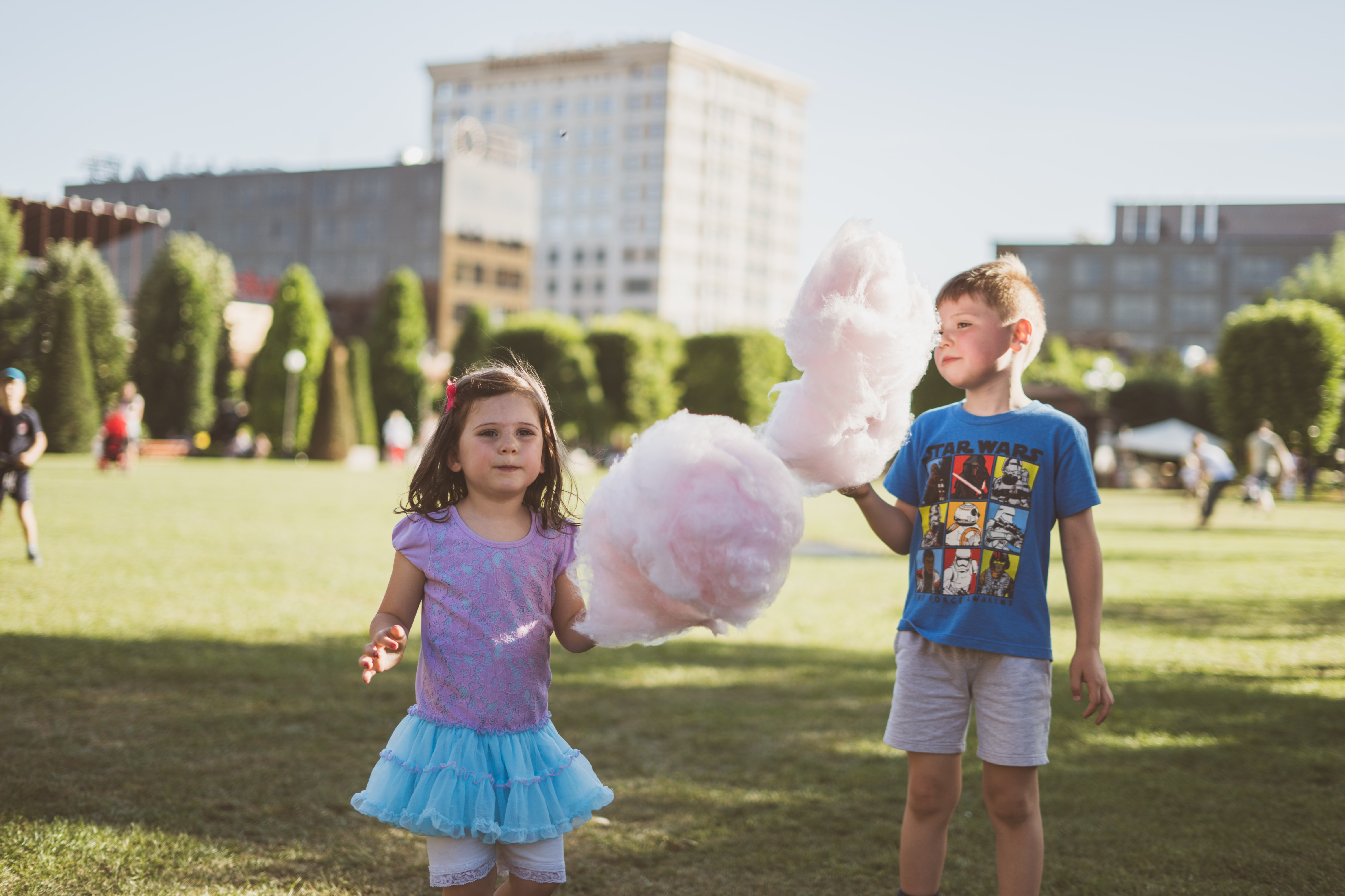 boy and girl eating cotton candies