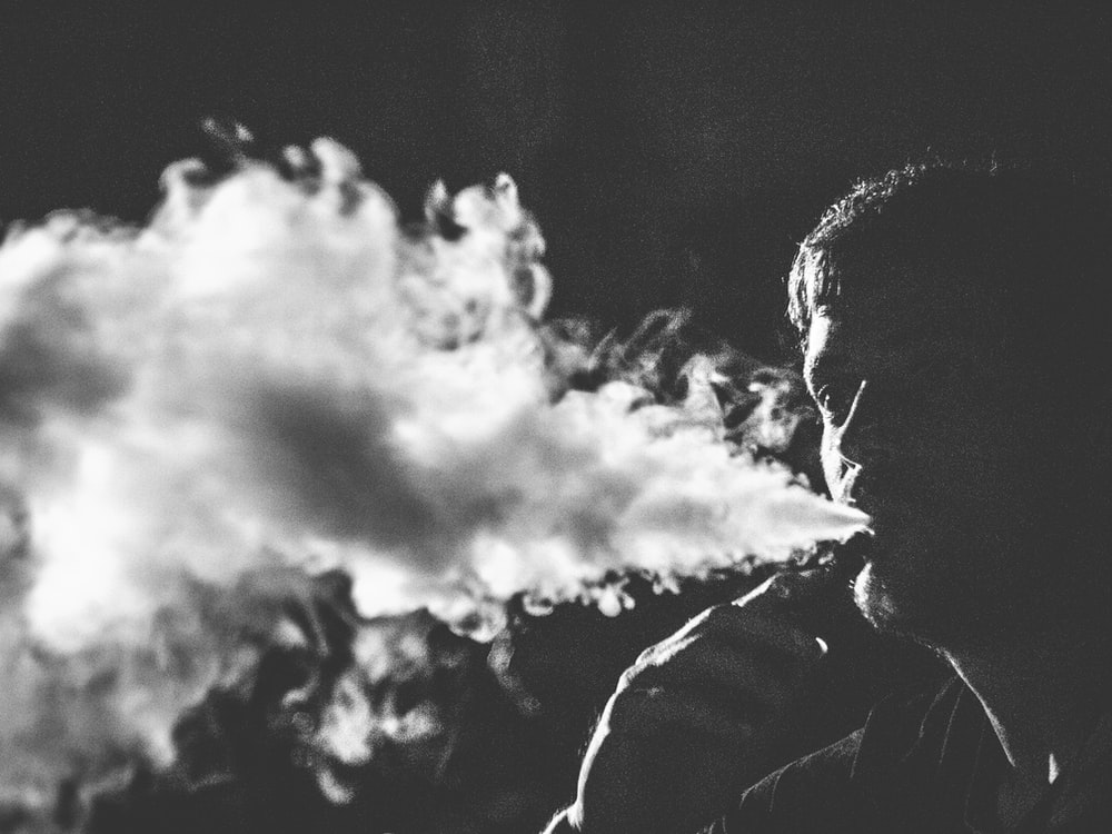 grayscale photography of smoking man