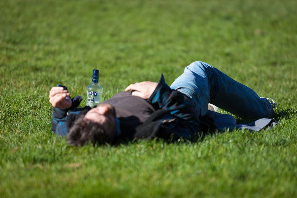 drunk student lying in the grass