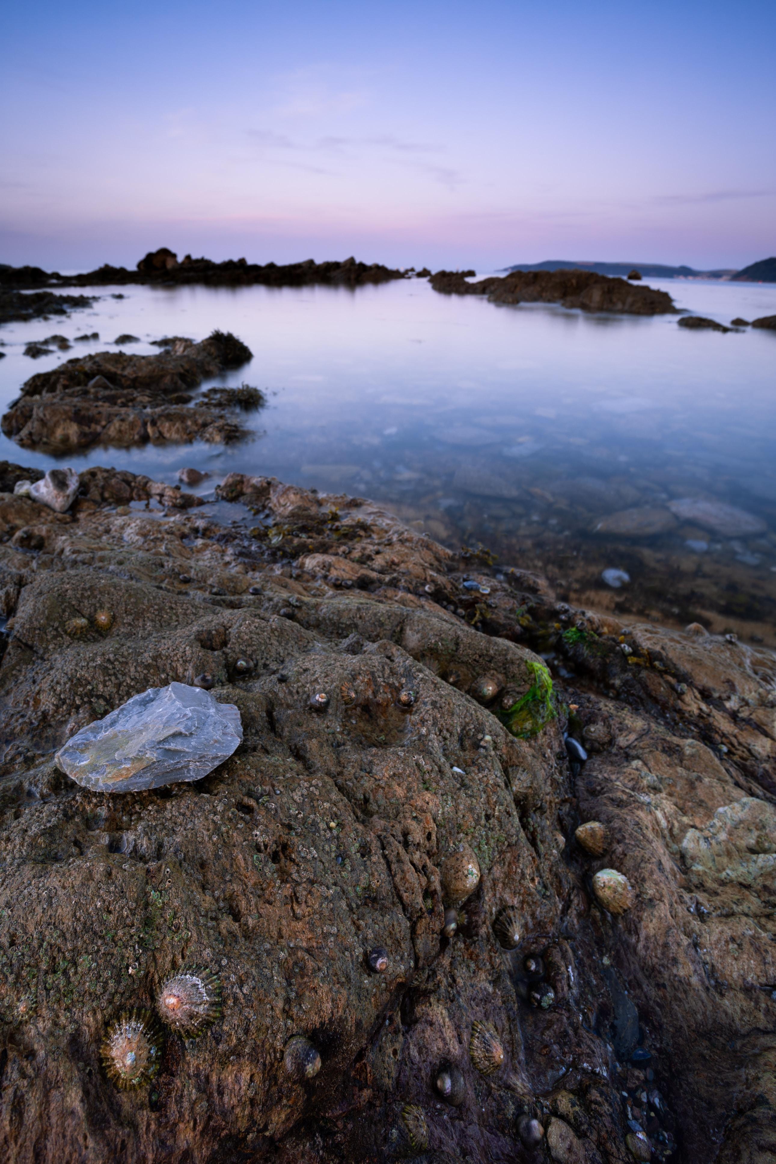 photo of rocks near body of water