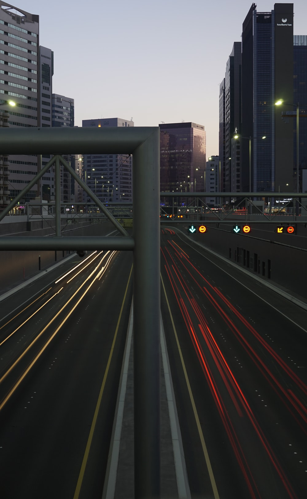 timelapse photography of road between buildings