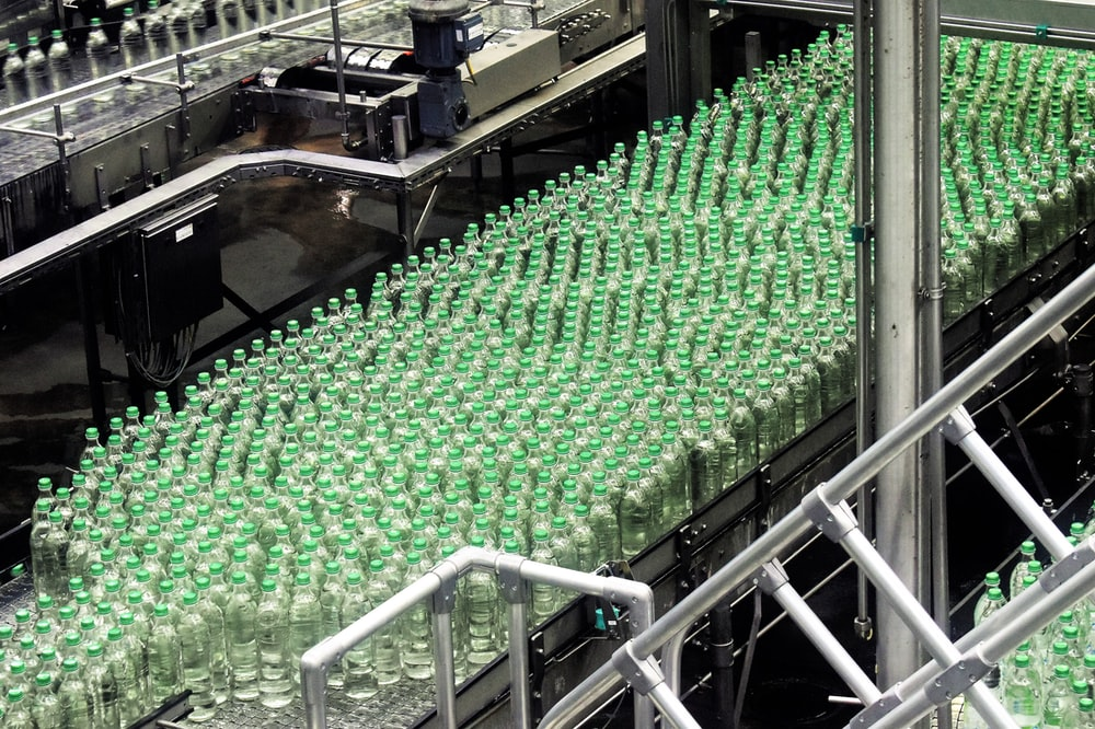glass bottles on top of gray machine