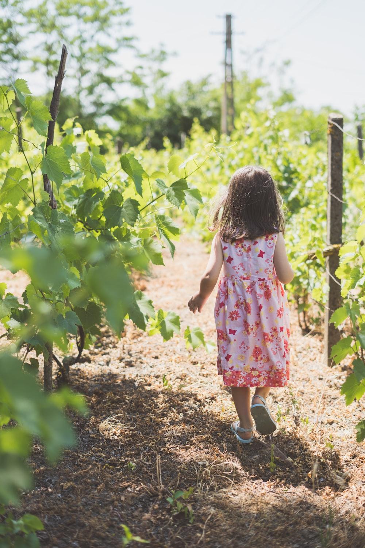 girl walking near plants