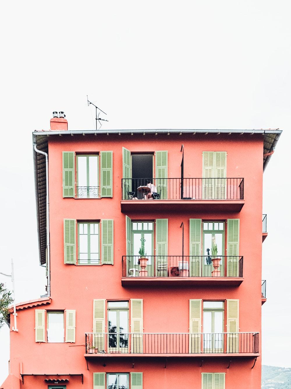 orange and green 4-storey building