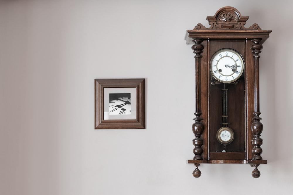 brown pendulum clock