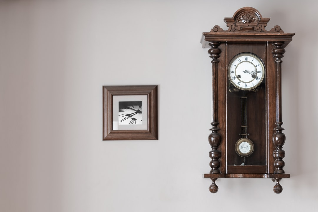 I visited my friends and asked if they'd allow me to photograph some of their house. They've got a cozy house with a lot of walls and corners like this one. I took three shots: this one, just the clock and the clock with way more framed paintings - and I chose this one.