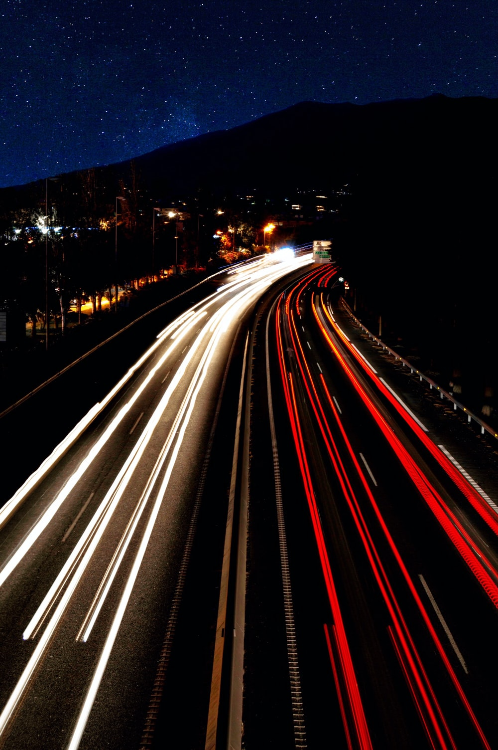 timelapse photo of vehicles on road during nighttime