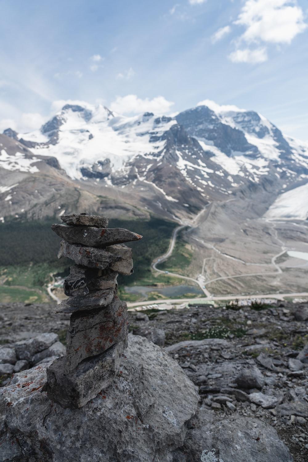 rock balancing during daytime