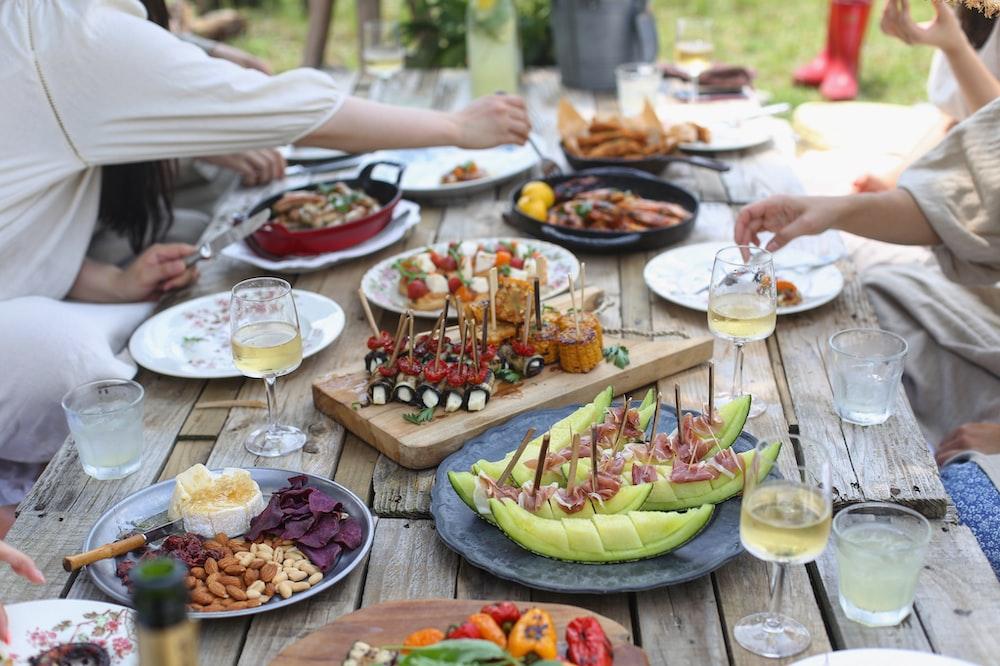 group of people eating on backyard