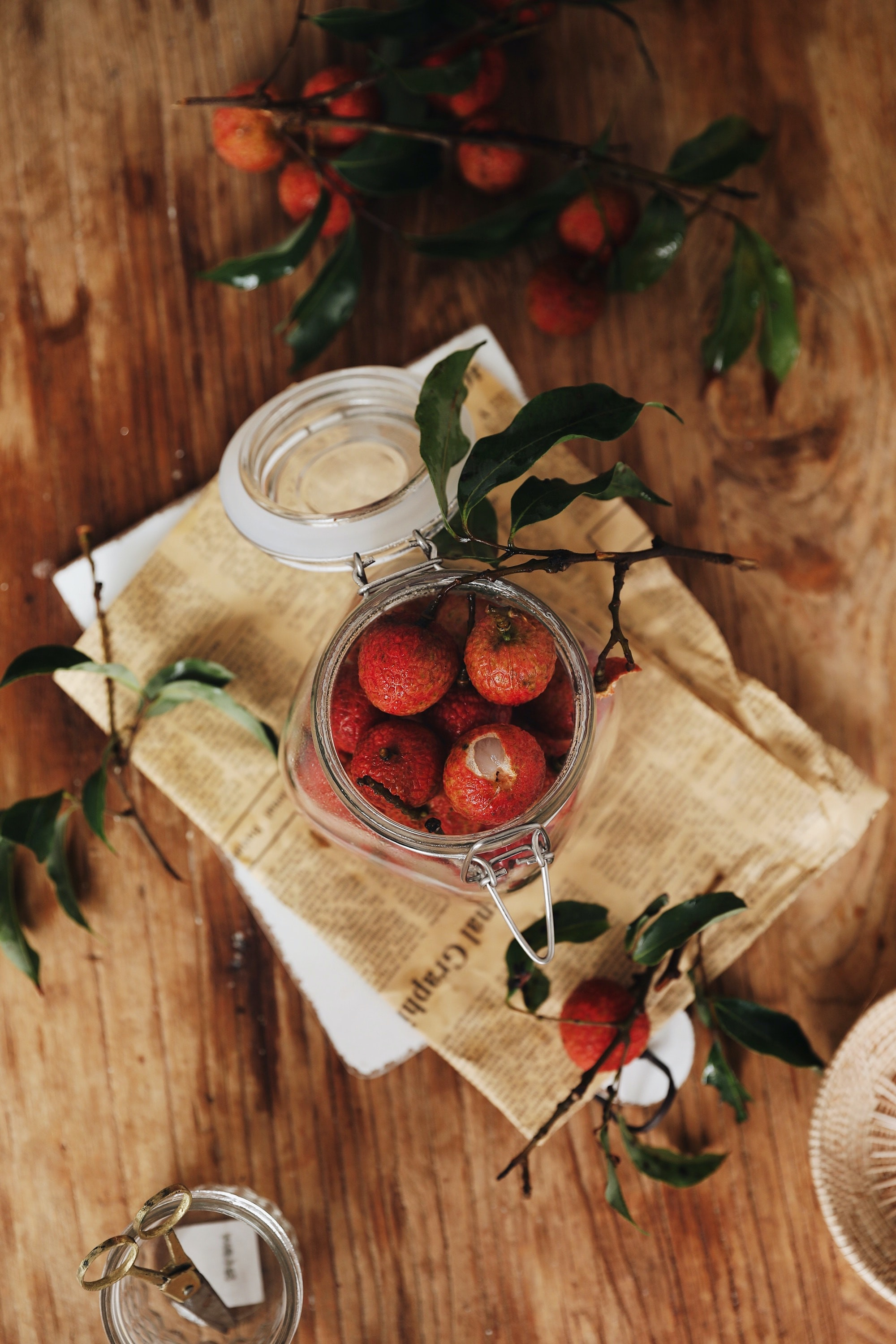 flat lay photography of jar of red fruits