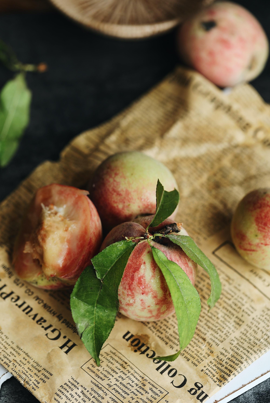 peach fruit on newspaper