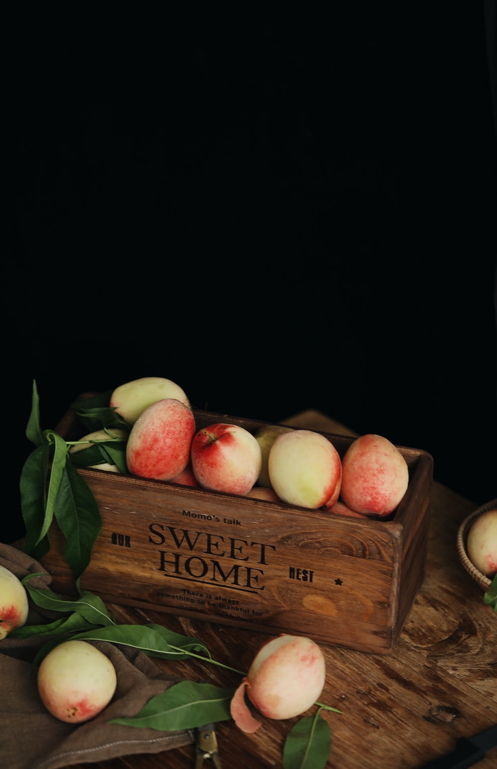 peaches in brown wooden box