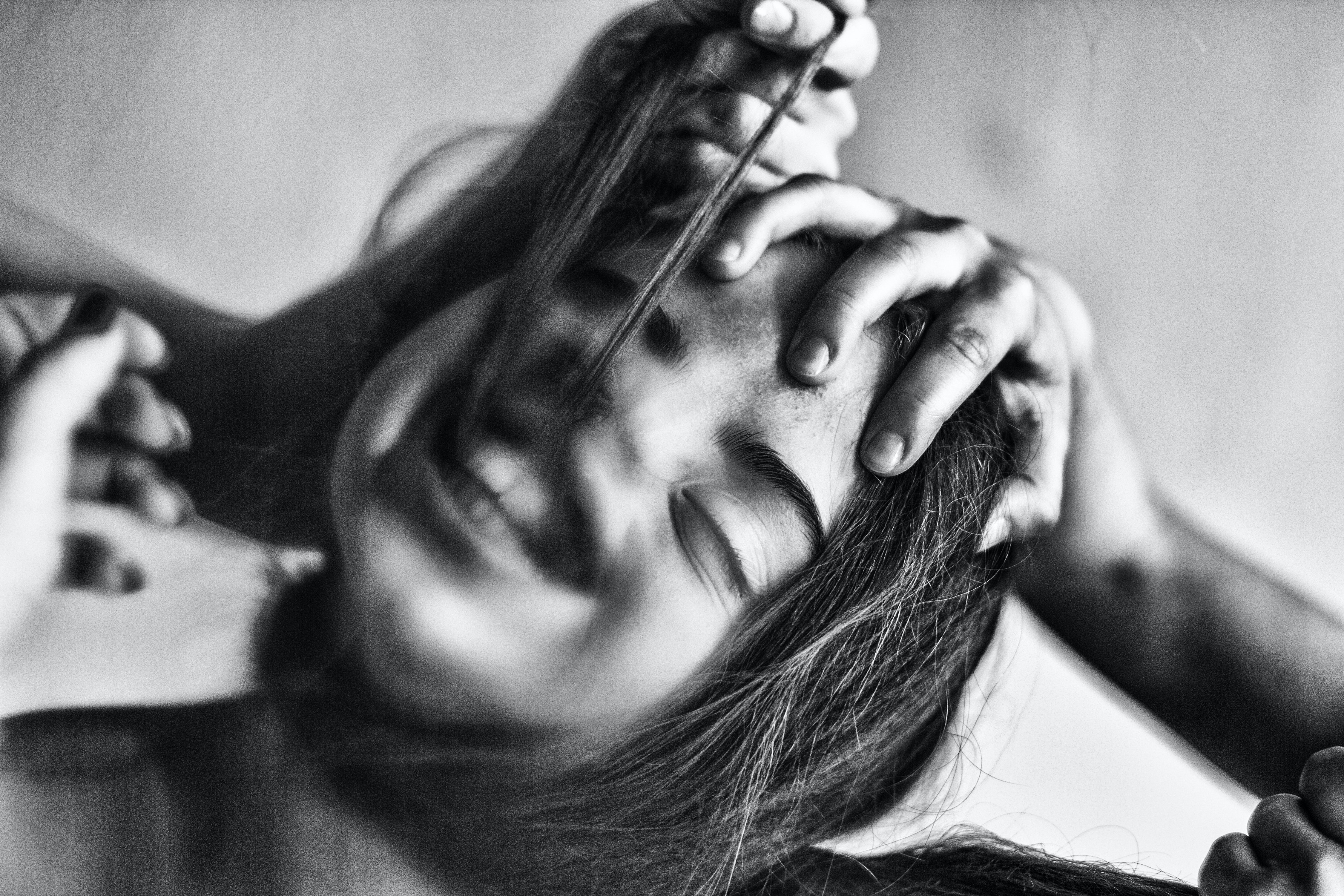 grey scale photo of girl laughing