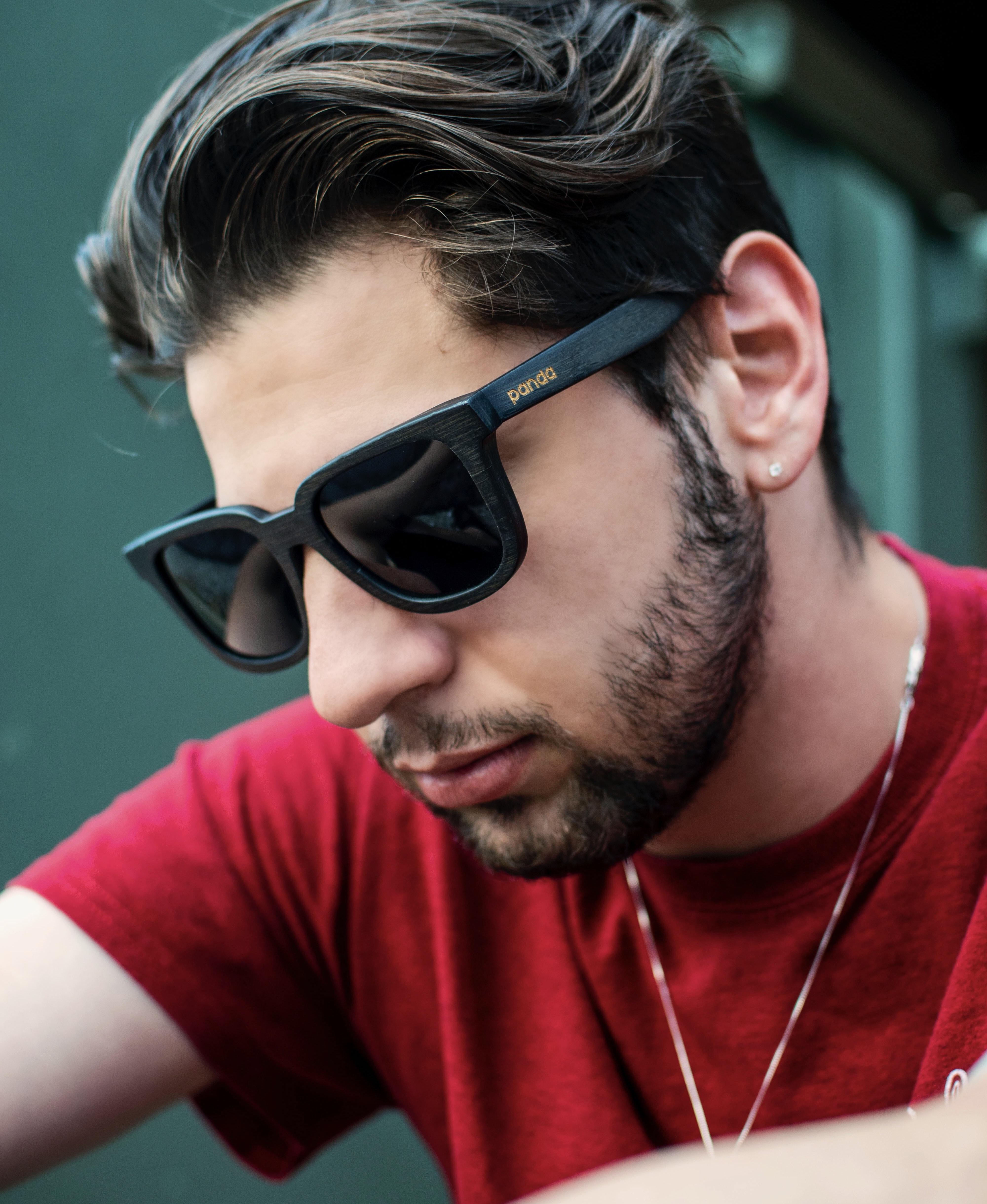 man wearing black sunglasses and red shirt
