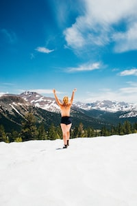 topless woman walking on snow