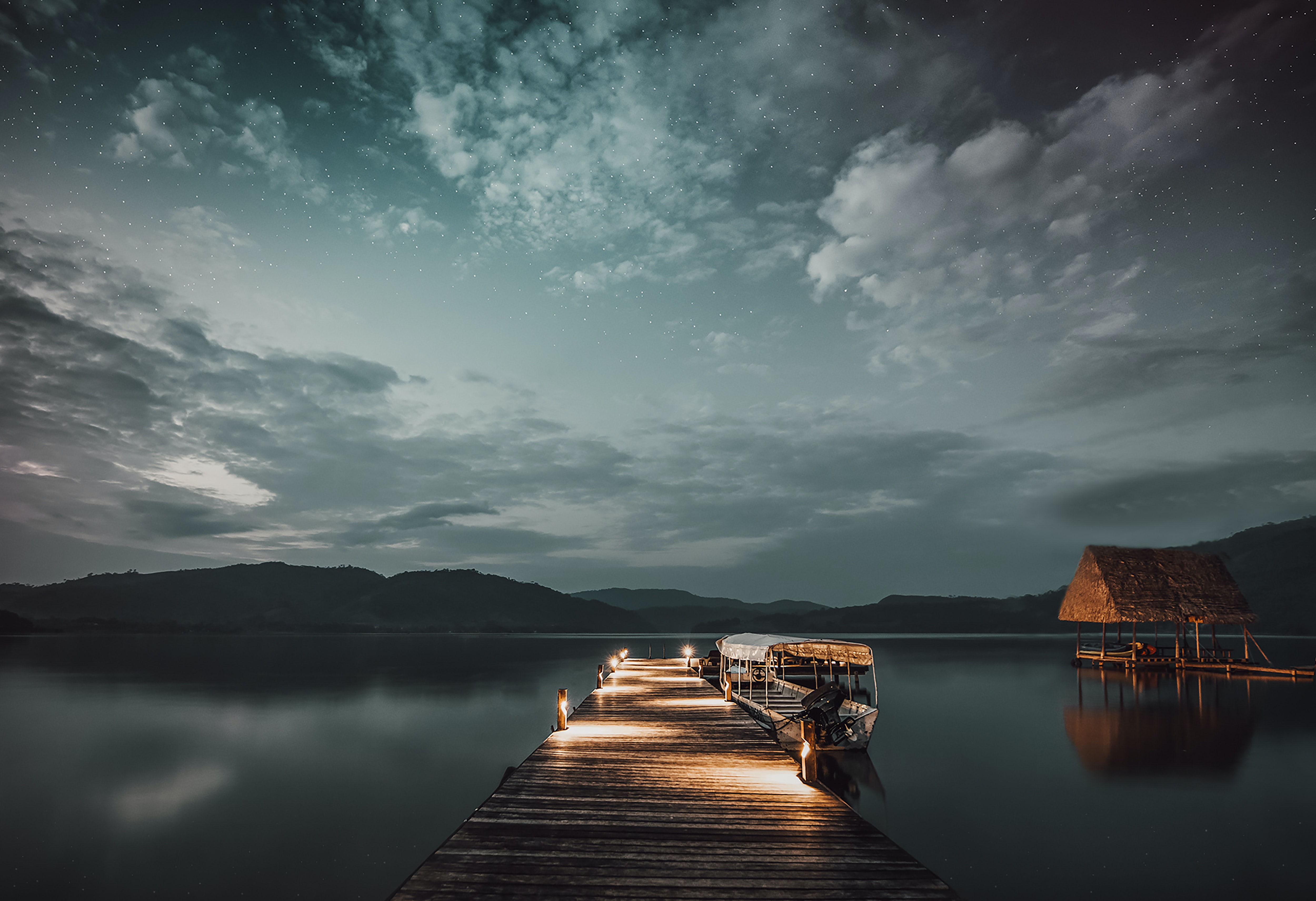 dock with lights during sunset