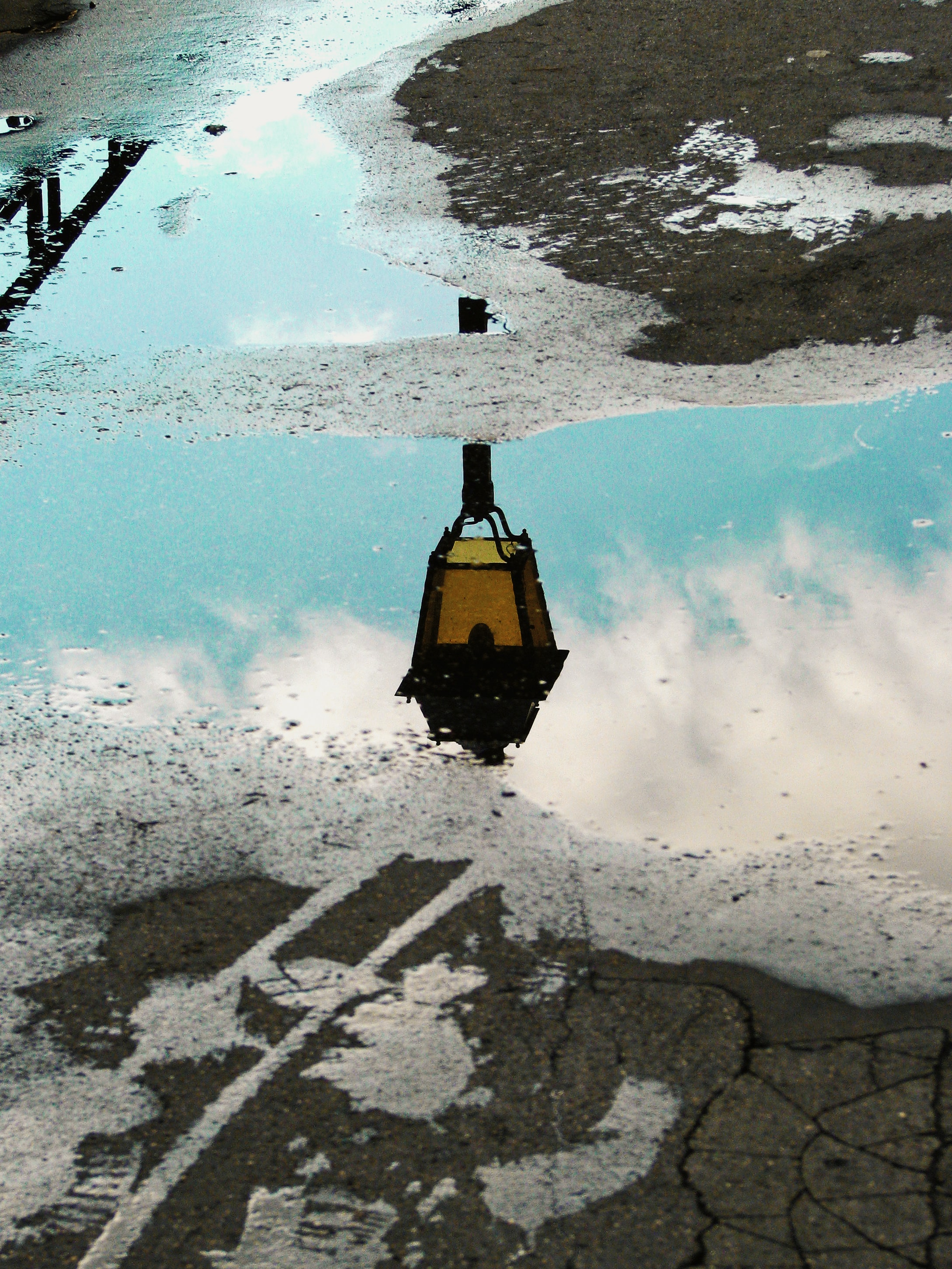 water mirror photography of street post