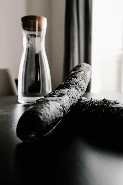 two black cigars near bottle