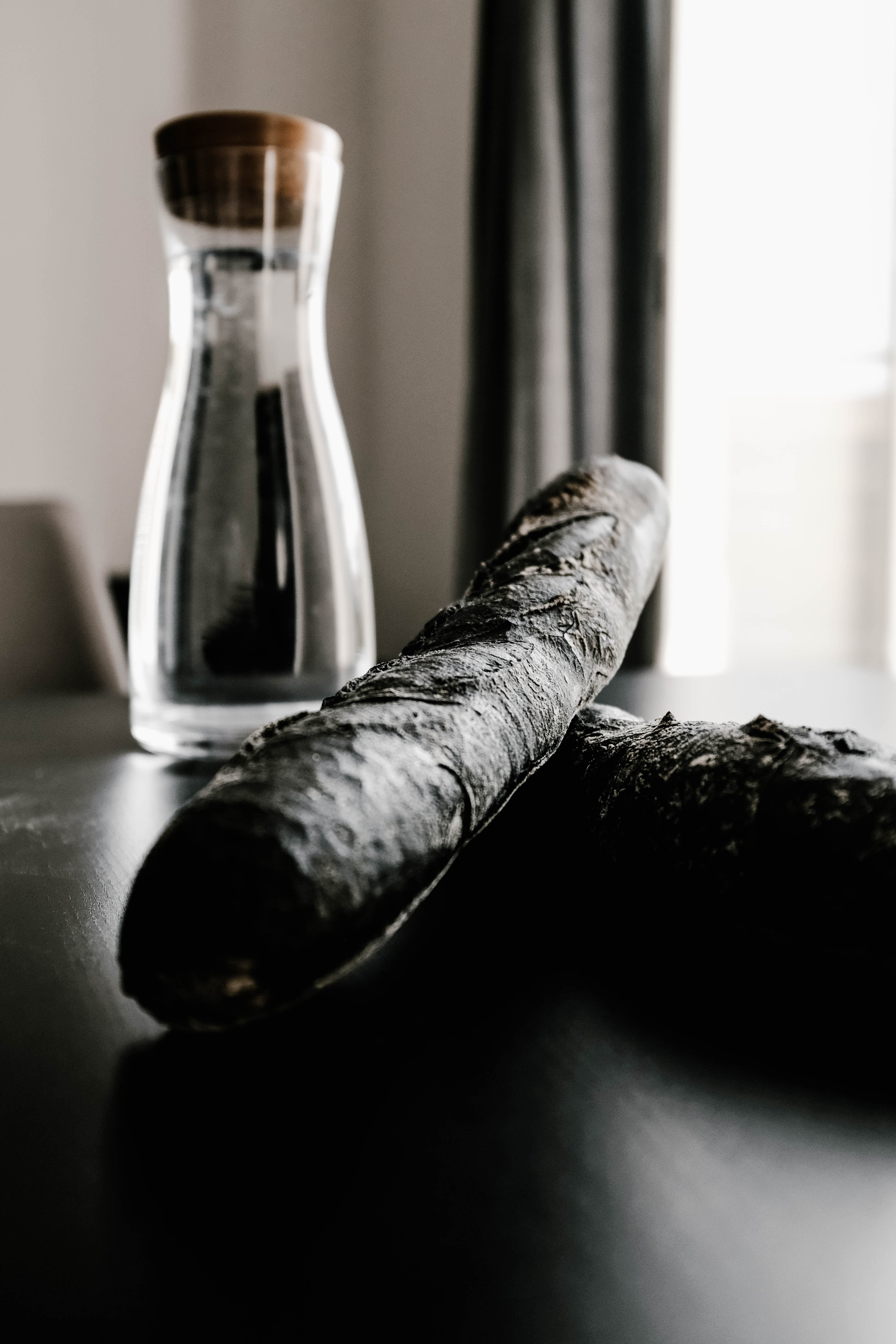 two black cigars near bottle