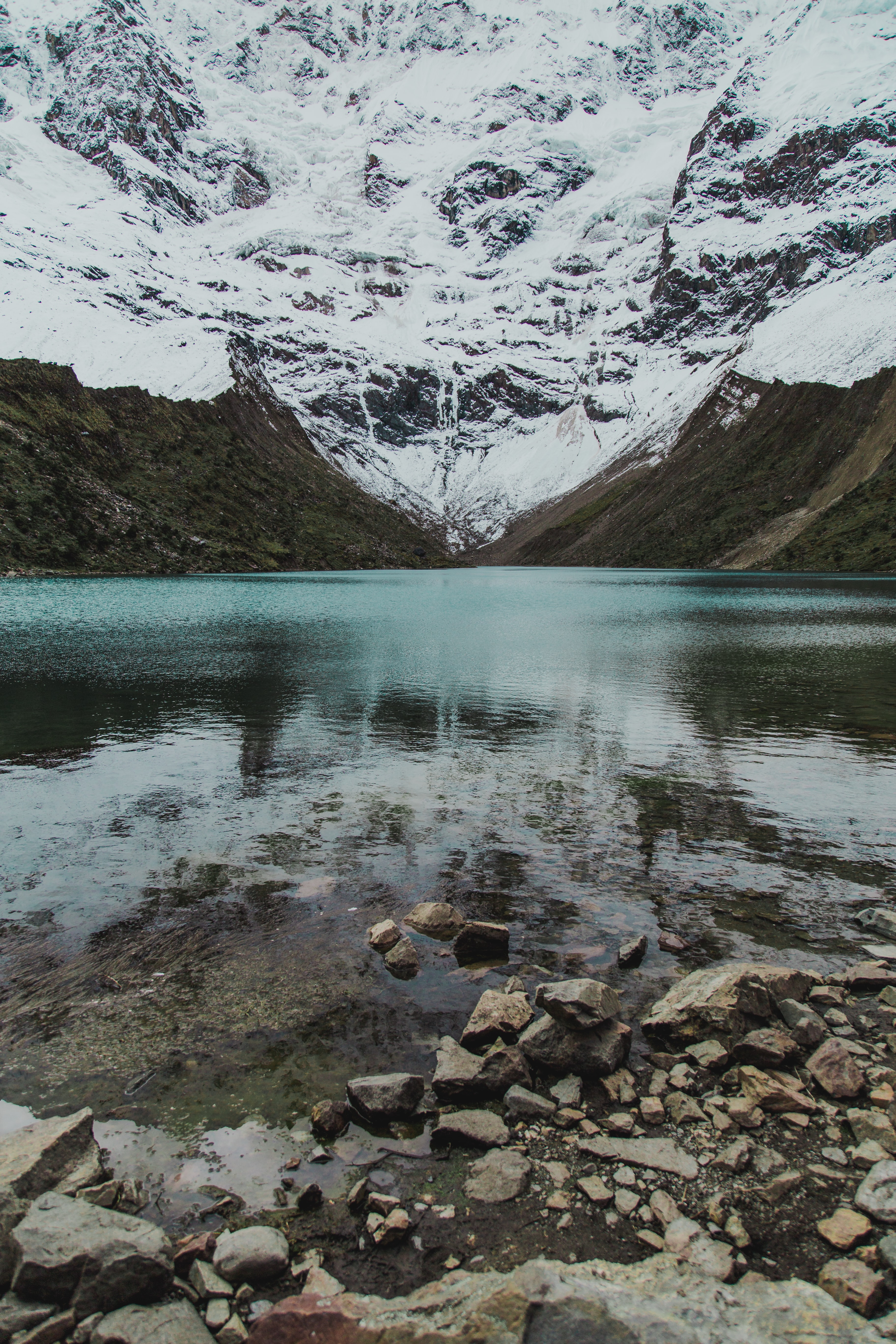 landscape photo of lake with snow alps