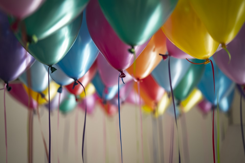 selective focus photography of assorted-color balloons