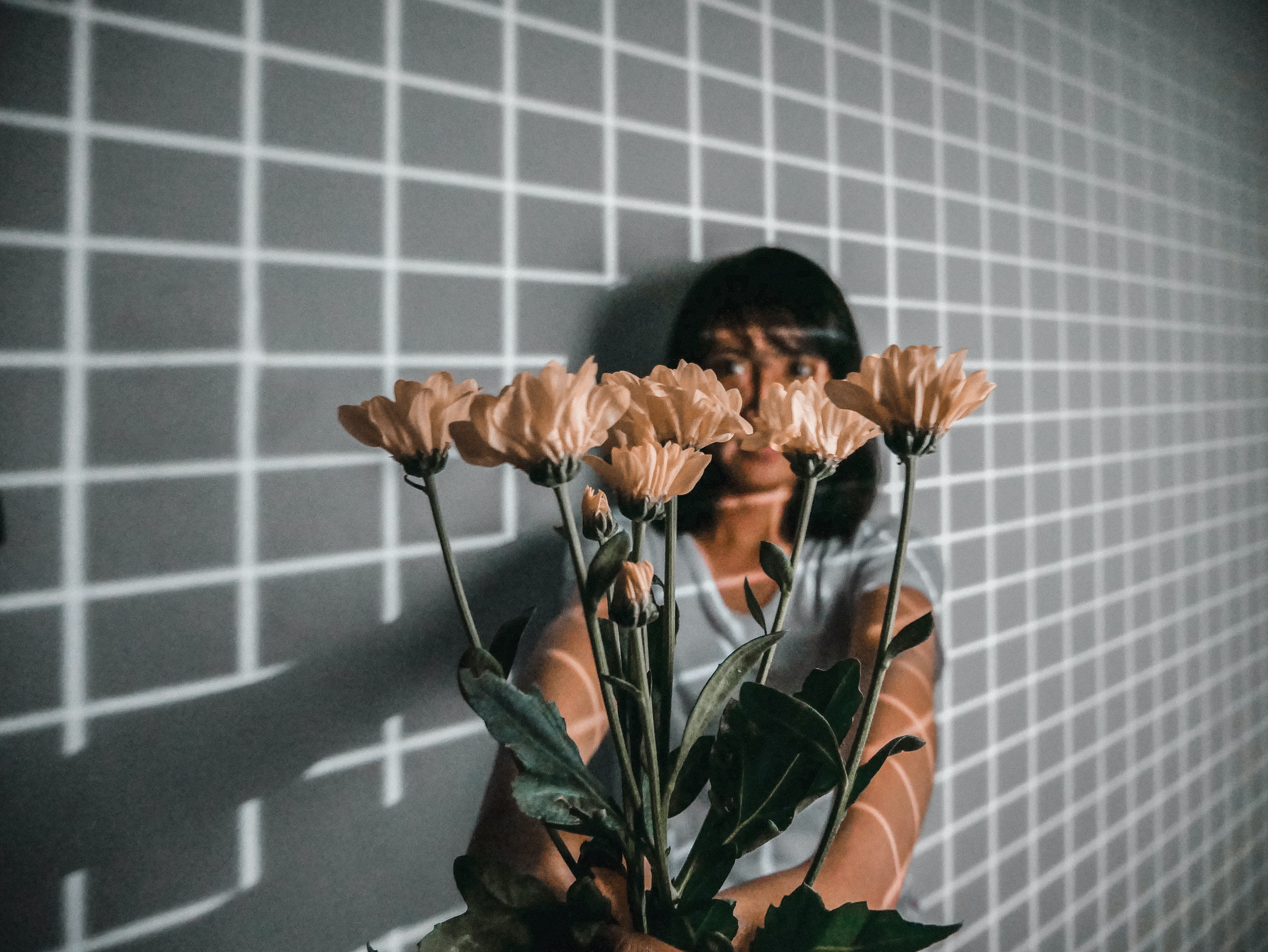 woman holding a flower