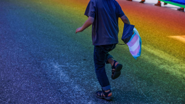 boy running through road