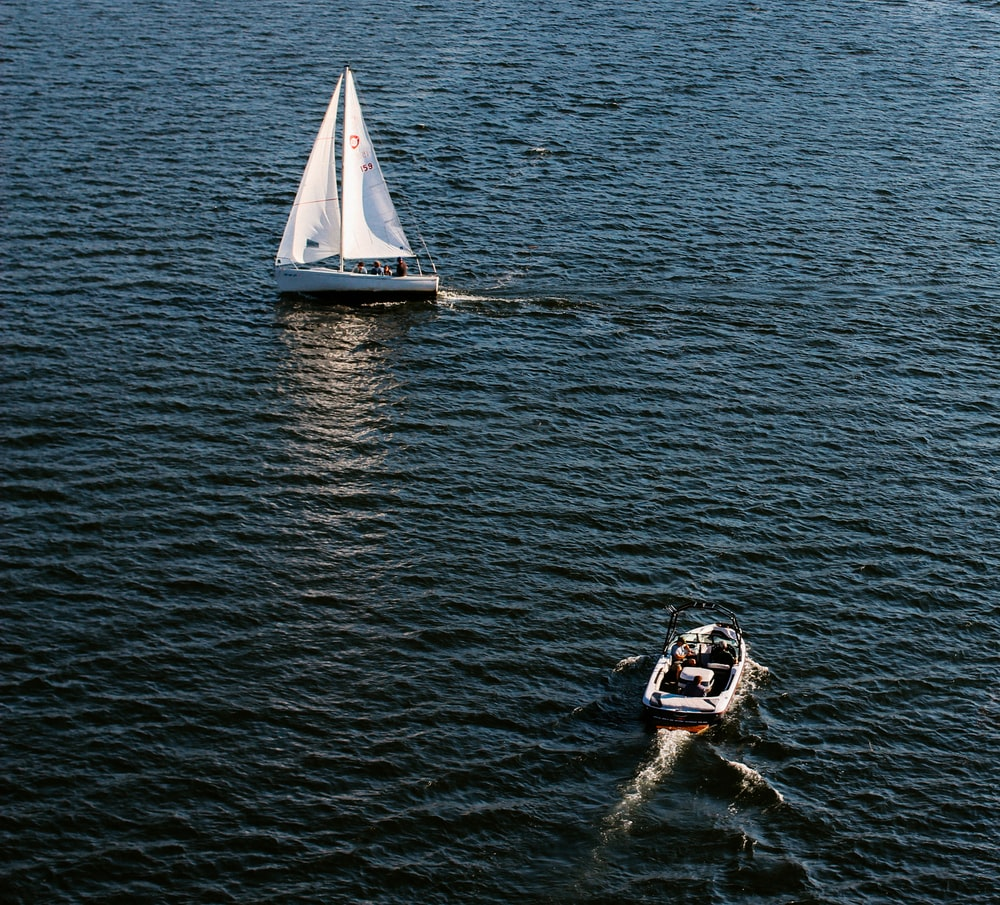 two white motorboats floating on water at daytime