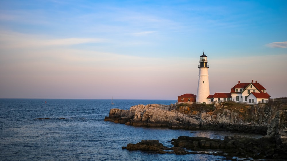 white lighthouse near body of water