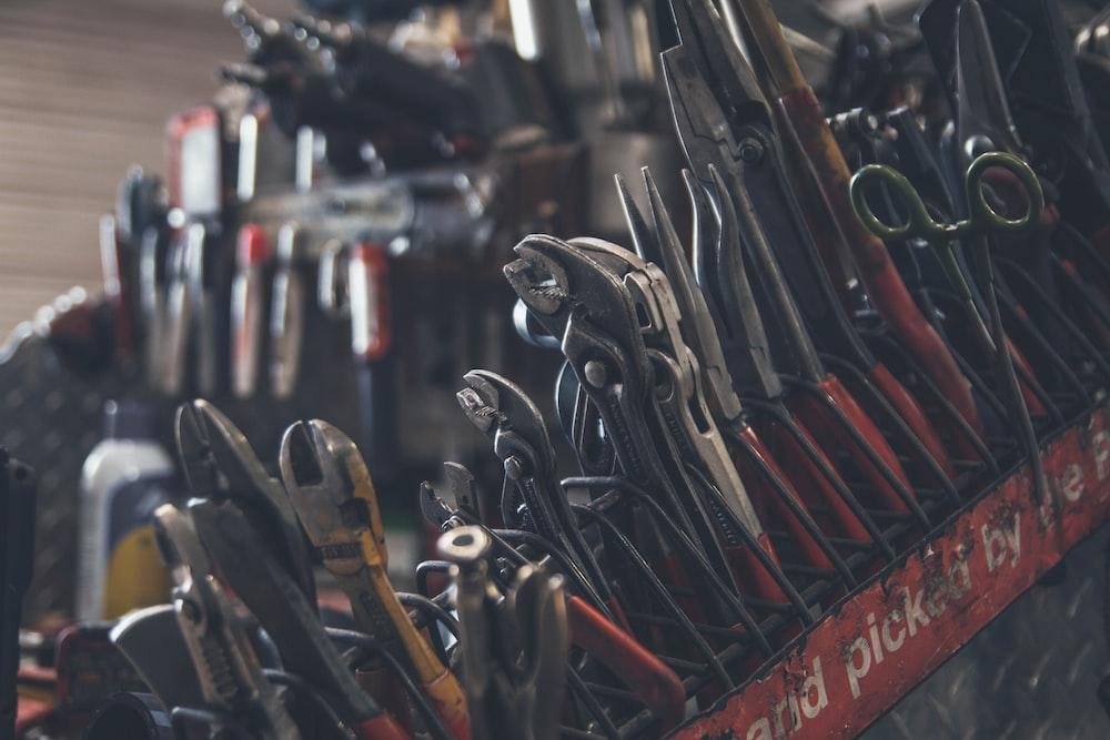 selective focus photography of mechanics tool lot