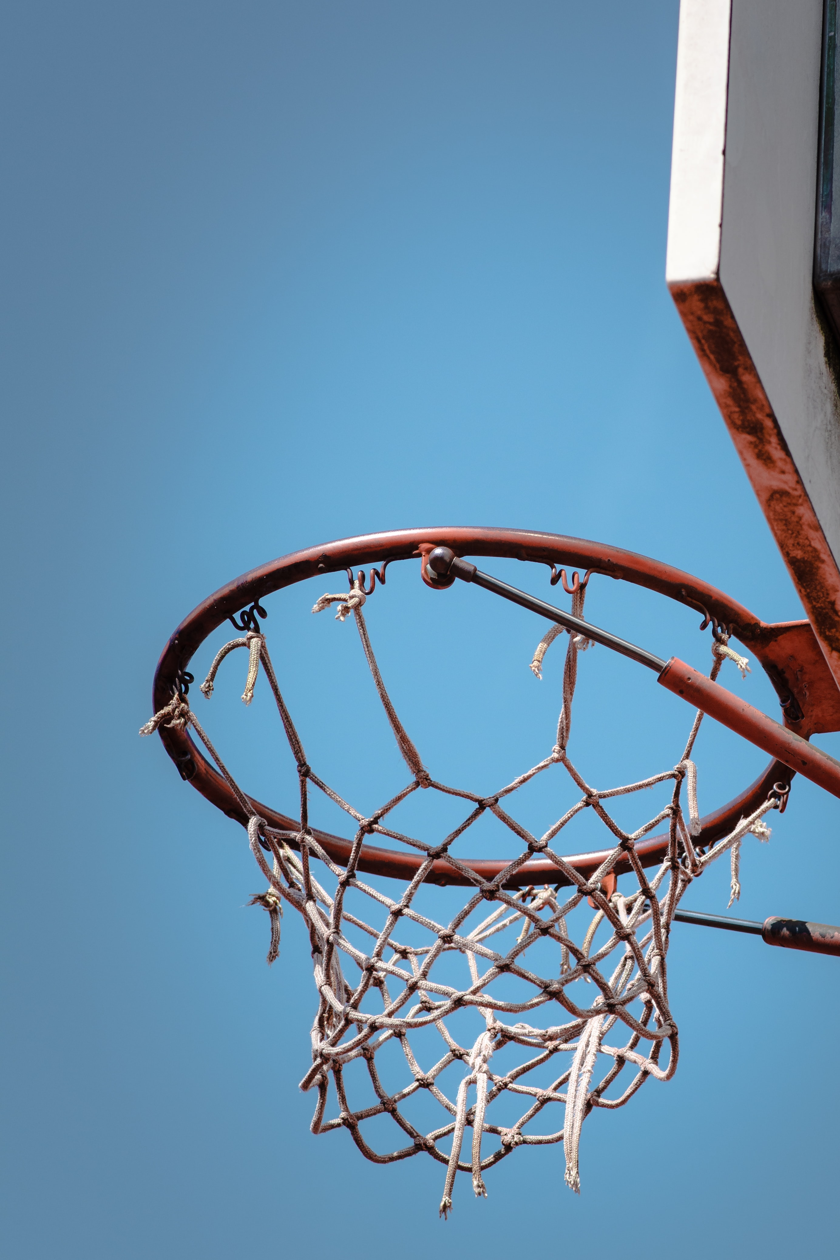 low angle photography of red and white basketball system
